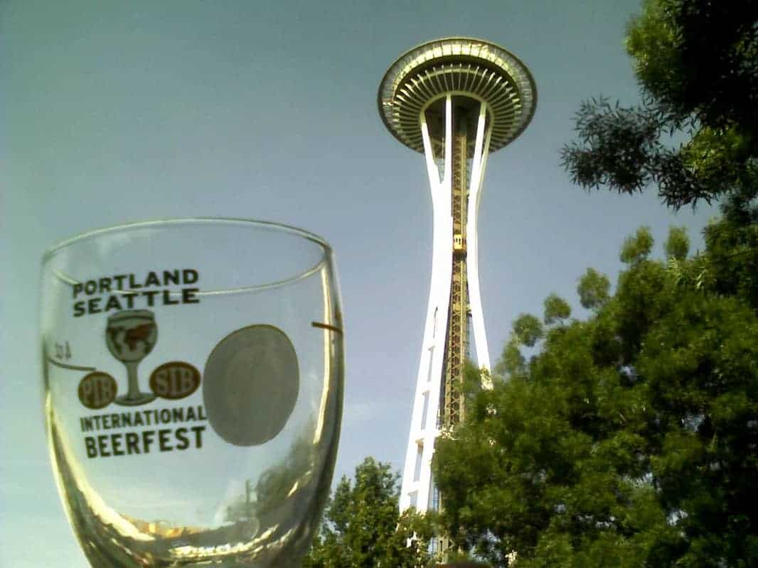 Portland Seattle International Beerfest wine glass held up with the Seattle Space Needle in the background