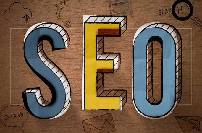 The word SEO, which stands for Search Engine Optimization, painted in different colors.