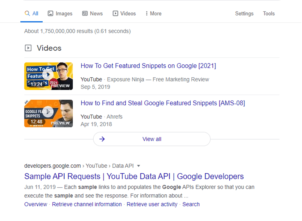 A screenshot of search result page displaying youtube videos at the top